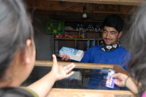 In the small shop Yasin sells Utensils for the daily Need, but also Books and self made Cake