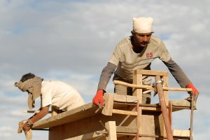 Jay, a participant of the Earth Construction Workshop, fixing the Formwork for the Rammed Earth Wall