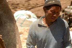 A worker mixing the Clay for the Bricks