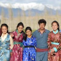 Simon, Stanzin, Padma tall, Padma small, C. Deleks and RIgzin in traditional dresses